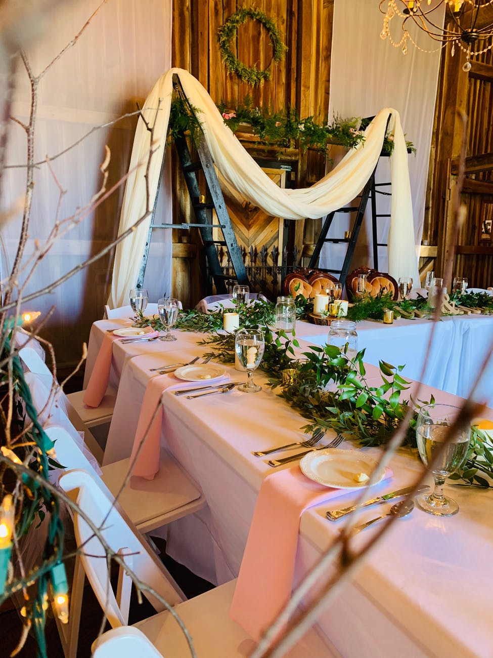 pink draped reception table