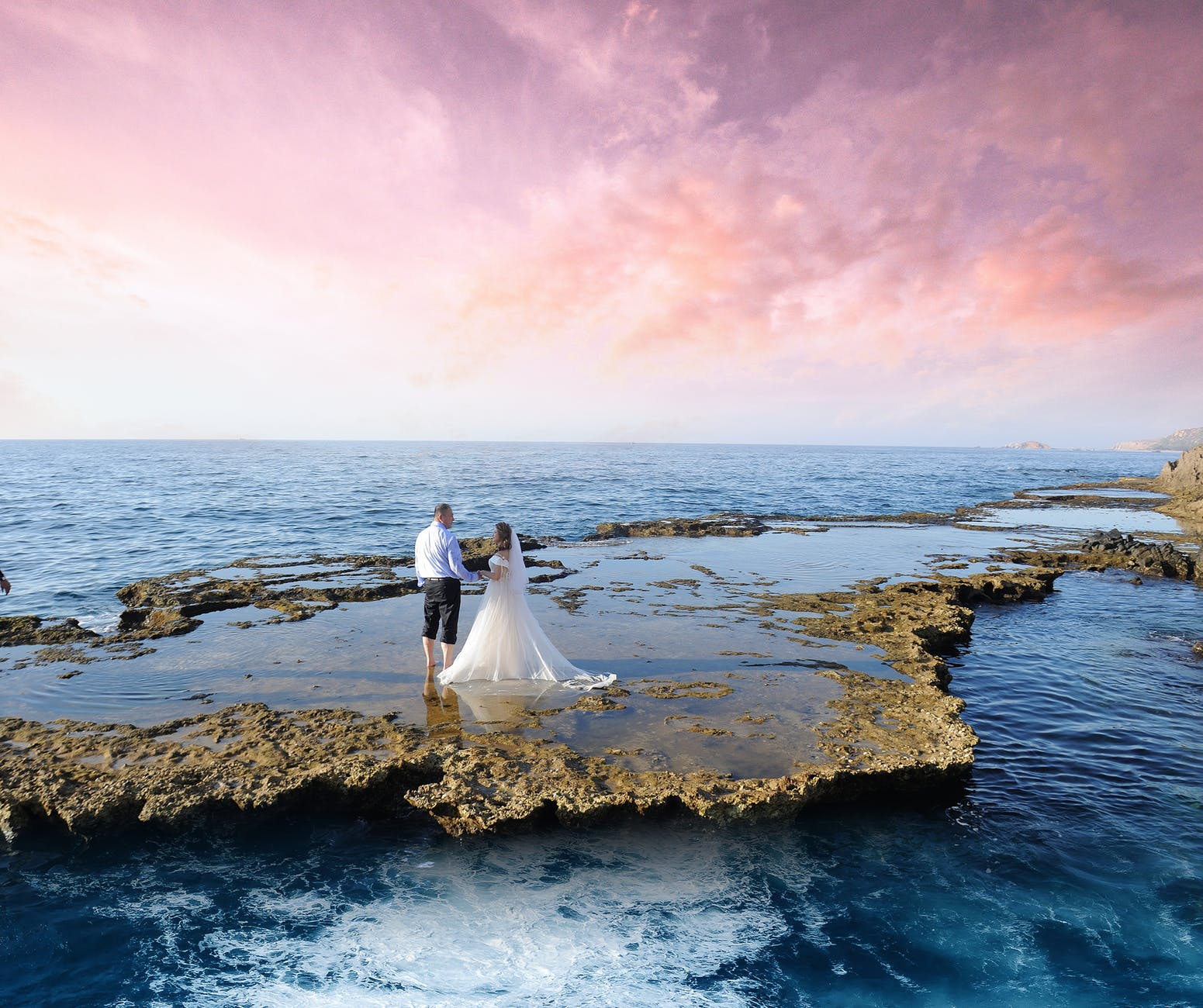 photo of couple on seashore during dawn